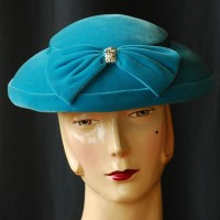 1950's blue velvet platter hat with front bow and rhinestone accent.