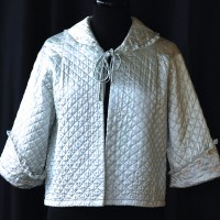 Classic Silk Underwear 1950's blue quilted bed jacket with hand embroidered collar and sleeves.