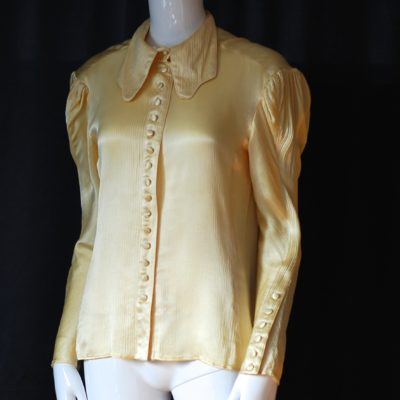 Alice Pollock pale golden long sleeved blouse with covered buttons, made in England