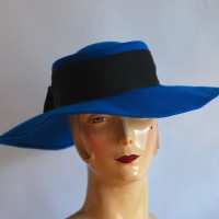 Fabini 1960's wide brimmed blue felt hat with black band and bow, made in New York