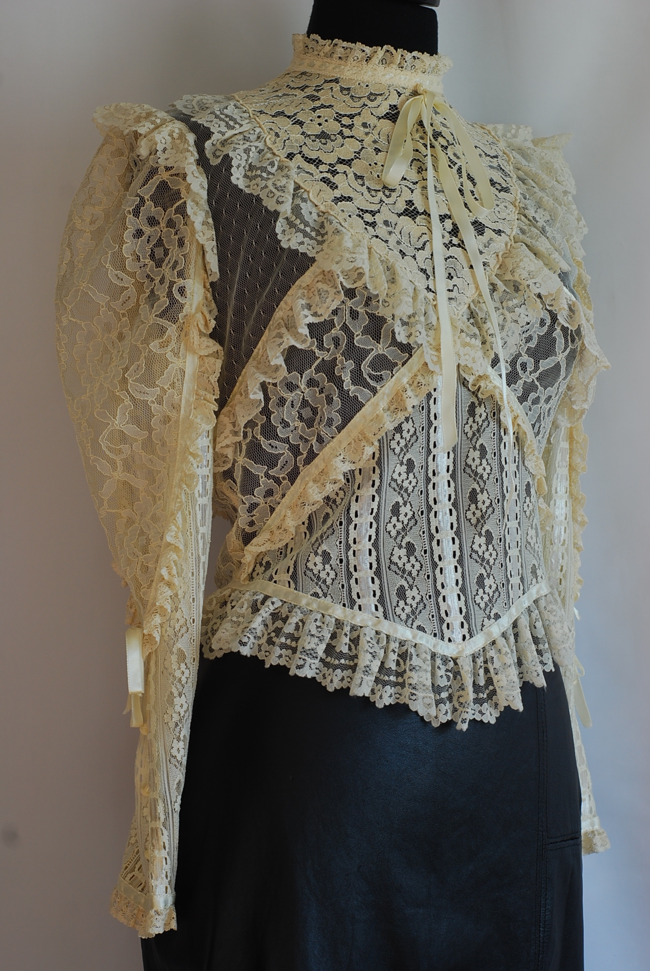 Mixed lace vintage blouse with leather skirt