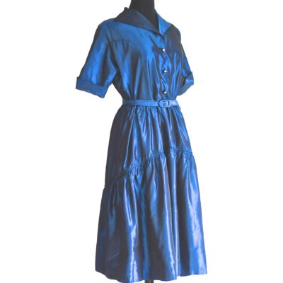 1940's vivid midnight blue taffeta dress with tiered skirt and rhinestone centred buttons.