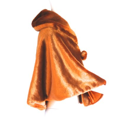Faux fur burnt ochre cape with front tie pom pons