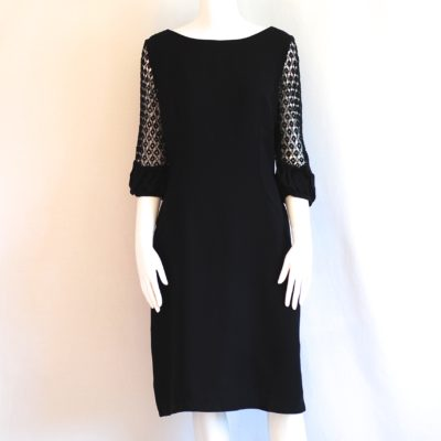 A Dress Town Original 1960's black dress with crochet sleeves. Made in Montreal, Canada