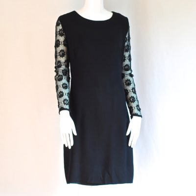 An Original J&S Missy Creation black knee length dress with embellished sleeves, made in Canada