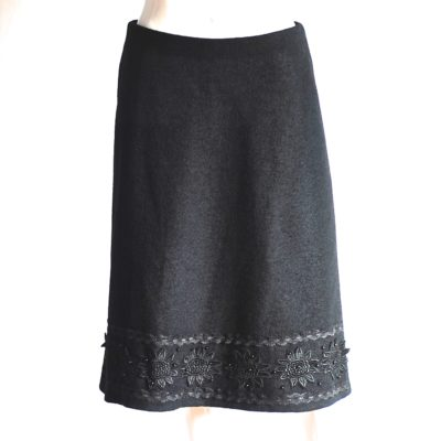 Khefer black wool skirt with beaded applique at the bottom, made in Italy