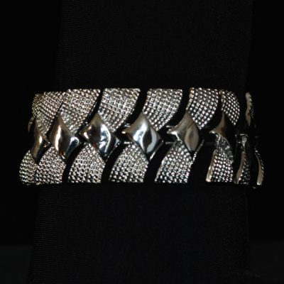 Coro 1940's Bracelet With rows of bows in silver tone textured metal
