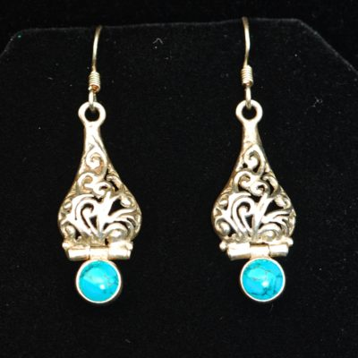 Artisan Nouveau Sterling silver dangling earrings with turquoise stones