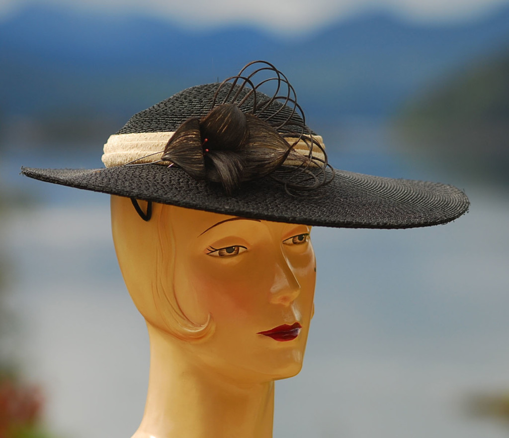 vintage hat with human hair accent and bokeh ocean view