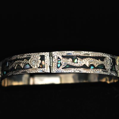 Taxco Intricately carved sterling silver bracelet with abalone inlay, made in Mexico