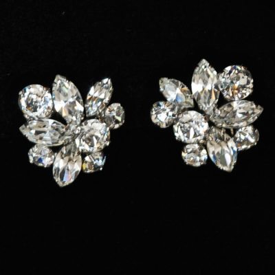 Gustave Sherman mid-century clear rhinestone ear clips, signed.