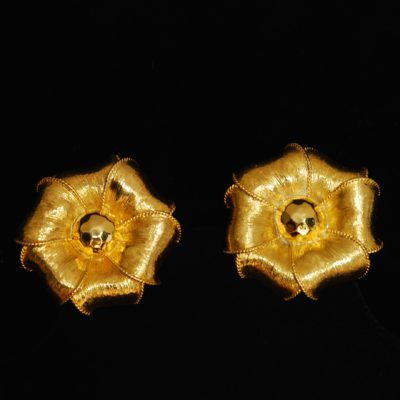 Givenchy gold tone flower shaped ear clips made of textured metal, signed on the back